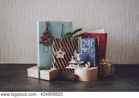 Christmas Sale, Xmas Shopping, Winter Holiday Sales, Black Friday. Many Paper Shopping Bags And Gift