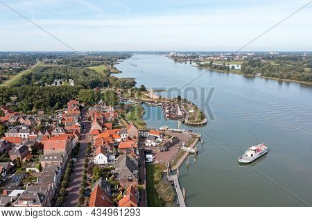Aerial from the historical village Woudrichem with the ferry arriving in the Netherlands