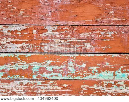 Old Shabby Wood Background, Vintage Texture With Peeling Red And Green Faded Paint. With A Horizonta