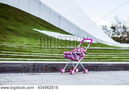The Child Lost Pink Pram. Baby Stroller Forgotten In A City. Toy Carriage For Dolls Left On The Stre