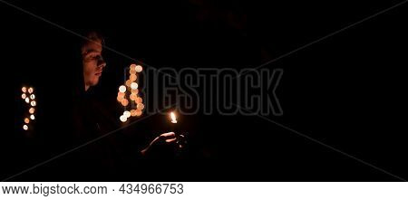 Catholicism Spiritual Culture Boy Portrait With Candle Flame In Hand For Worship Service Time, Dark