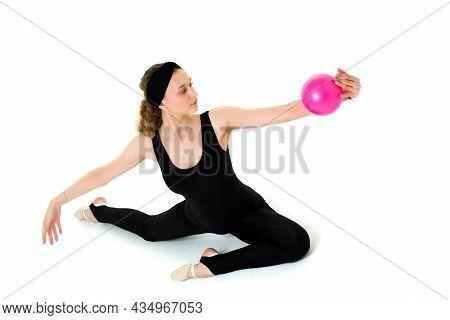 Flexible Teen Girl In Leotard Doing Rhythmic Gymnastics. Attractive Athlete Girl Wearing Black Bodys