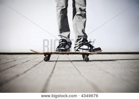Skater Standing On His Skateboard