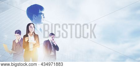 Attractive Young European Businesspeople Standing Together On Abstract City And Sky Background With