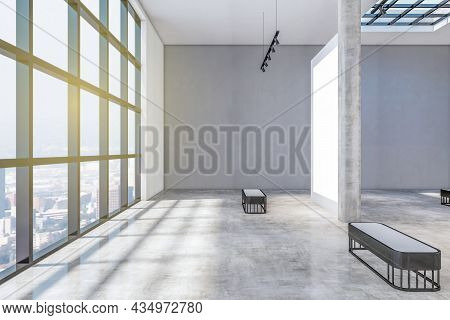 Bright Concrete Gallery Interior With Windows And City View, Daylight, Empty Posters And Shadows. Ex
