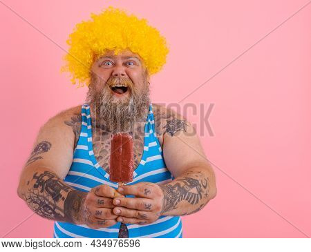 Fat Amazed Man With Beard And Wig Eats A Popsicle