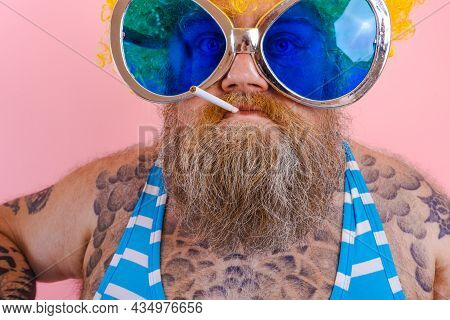Fat Angry Man With Beard And Wig Smokes Cigarettes