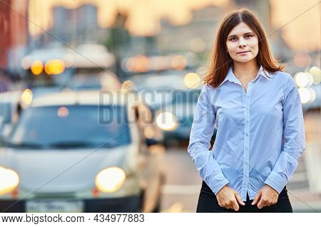 European Woman 26 Years Old Is Walking Near Traffic At Summer Evening.