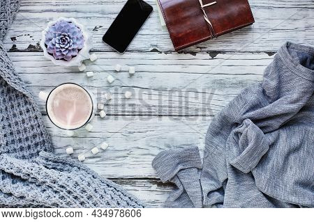 Autumn Or Winter Background Shot From Top View With Hot Cocoa, Houseplant, Cell Phone, Book, Throw B
