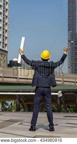 Success Businessman Engineer Hold Winner Fist Pump Blueprint Punching The Air As Victory Business Mo