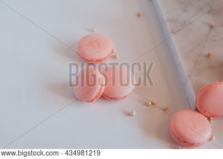 Pink Macaroons With Rose On Marble Table, Colorful Cookies On White Background, Pastel Colors. Vinta