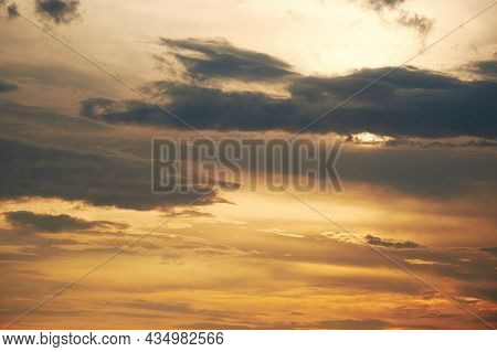 Dramatic Cloudy Sky In The Dusk Sunlight. Twilight Golden Colors In The Sky