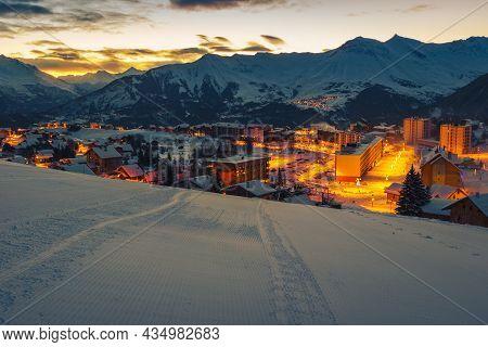 Beautiful Alpine Winter Ski Resort With Majestic Street Lights At Dawn. Mountain Resort And Ski Slop