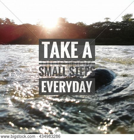 Inspirational And Motivational Quote With Blurry Background. Take A Small Steps Everyday.