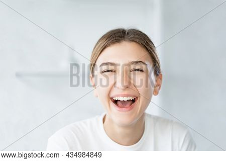 Laughing Woman. Dental Care. Beauty Wellness. Joyful Smiling Model With Fresh Radiant Face Skin On L