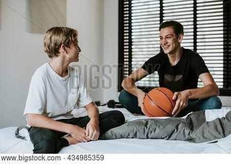 Siblings bonding over a basketball conversation