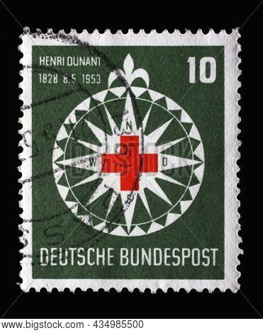 ZAGREB, CROATIA - JUNE 25, 2014: Stamp printed in Germany, shows symbol of the Red Cross in a stylized wind rose, circa 1953