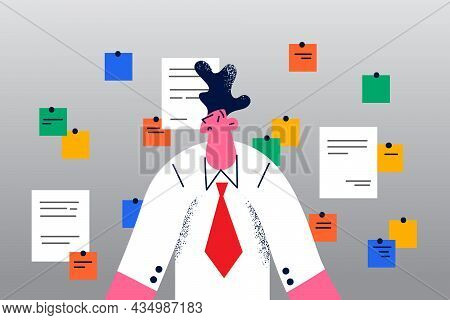 Much Work And Reminders Concept. Young Stressed Frustrated Man Office Worker Standing With Many Colo