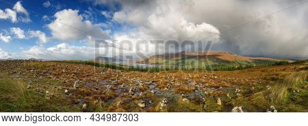 Panorama of stone stacks in the Scottish Highlands, overlooking the Ardochy Forest towards Loch Garry, Scotland, UK