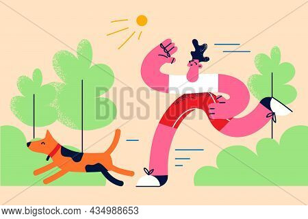 Active Lifestyle With Pets Concept. Young Smiling Man Boy Running Jogging Making Training In Park On