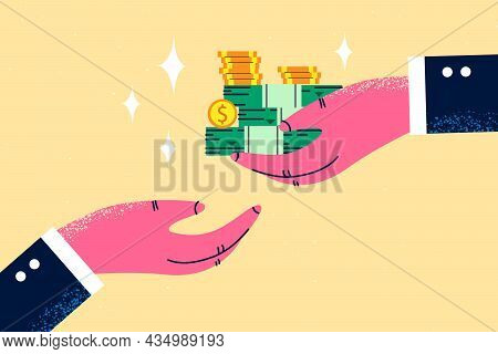 Giving Bribe And Financial Crime Concept. Human Hand Holding Heap Of Dollars Cash Money Giving Bribe