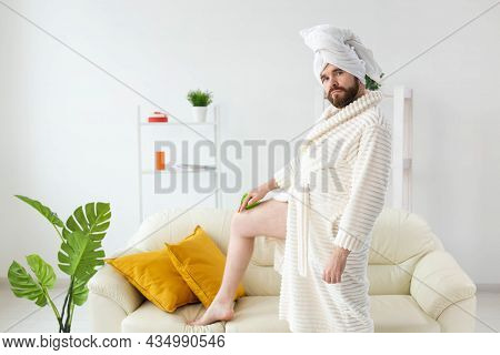 Funny Bearded Man Wear Turban Towel Makes Himself A Massage With Massage Brush. Male Skin Care And S