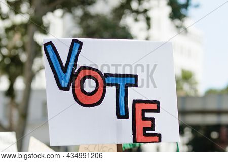 Vote typography on a white placard at a black lives matter protest