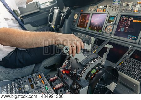 Pilot Is Piloting Airplane From Airplane Cockpit