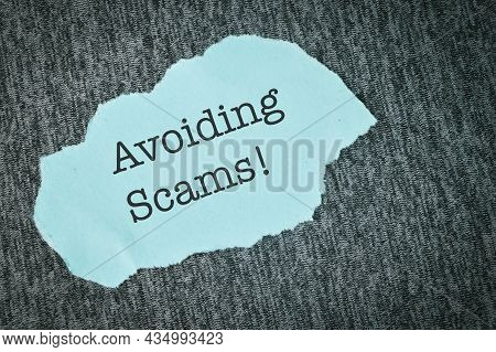 Blue Torn Paper Written With Text Avoiding Scams!