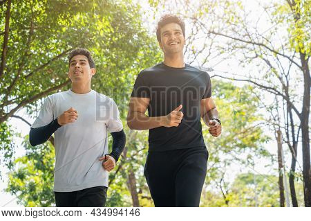 Two Handsome Healthy Runner Jogging Outdoor. Fitness And Sport Healthy Lifestyle Concept.