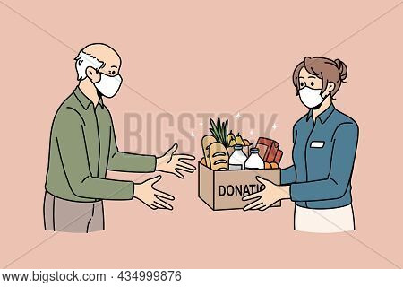 Charity And Donating Food Concept. Young Woman Volunteer In Medical Protective Mask Giving Box With