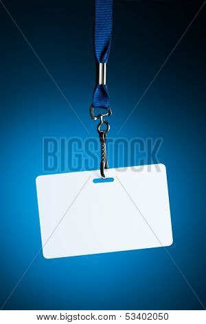 empty white badge backdrop against blue background