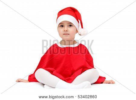 Child In Santa Claus Hat Sitting On White