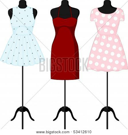 Different dresses on a mannequin.