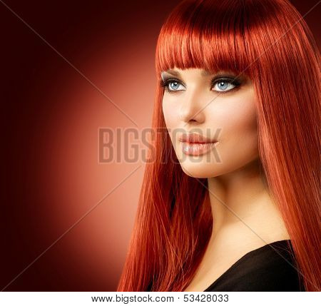 Beauty Woman Portrait. Red Hair Model Girl Face. Sexy Woman with Long Shiny Straight Red Hair Isolated on White Background. Fringe Hairstyle. Hair Extensions. Beautiful Makeup. Perfect Skin