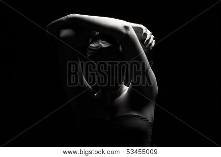 Woman Holding Arms Over Her Head