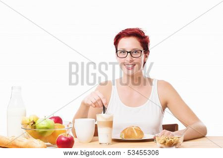 Happy Woman At Breakfast With A Coffee