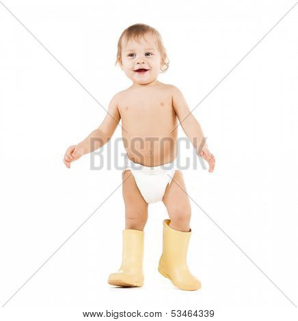 childhood and toys concept - cute little boy walking in big rubber boots