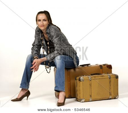 Waiting girl whit two portmanteau close up poster