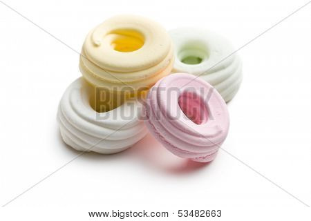 colorful meringues on white background