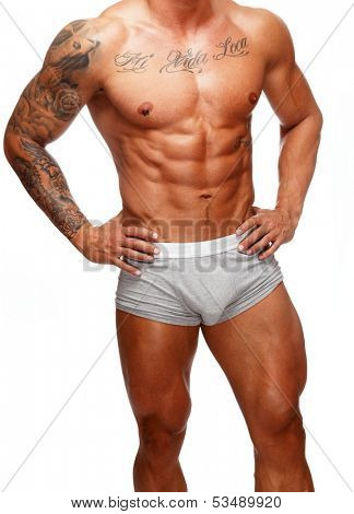 Man with beautiful muscular tattooed torso in underwear