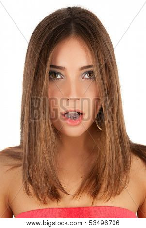 Beautiful girl hold ice cube in mouth