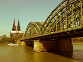 Vintage look Koeln (Germany) panorama including the gothic cathedral and steel bridge over river Rhine poster