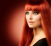 Beauty Woman Portrait. Red Hair Model Girl Face. Sexy Woman with Long Shiny Straight Red Hair Isolated on White Background. Fringe Hairstyle. Hair Extensions. Beautiful Makeup. Perfect Skin poster