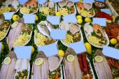 Prepared raw seafood fish plates on Mediterranean market poster