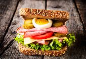Single toast sandwich on the wooden background poster