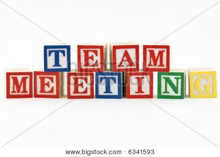 Team Meeting in wooden blocks