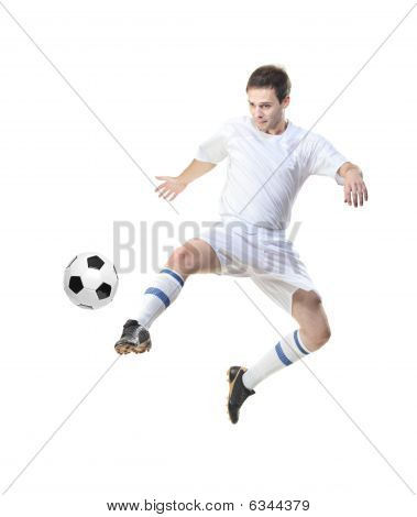 Football Player In Jump With A Ball