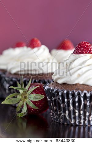 Chocolate Cupcakes Topped With Strawberries