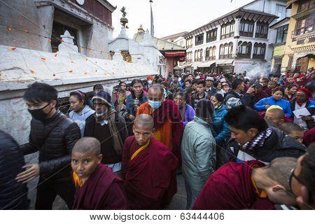 KHATMANDU, NEPAL - DEC 15, 2013: Unidentified Buddhist pilgrims near stupa Boudhanath during festive solemn Puja of H.H. Drubwang Padma Norbu Rinpoche's reincarnation's.